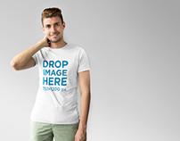 T-Shirt Mockup of a Smiling Young Man at a Photo Studio