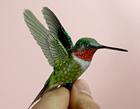 Paper and wood Ruby throated hummingbird sculpture