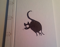 Japanese binding with a cheeky cat illustration.