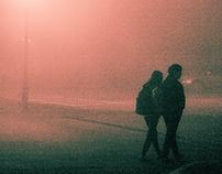 Fog-shrouded school scene at night