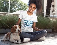 Girl Wearing a Tshirt Mockup while Petting her Dog