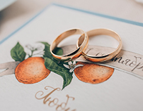 Wedding stationery with oranges and bluebells