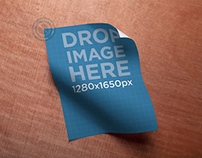 Poster Mockup Lying on a Wooden Surface