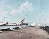 Aircrafts seen through a window with raindrops