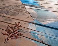ilustración acuática sobre madera reciclada