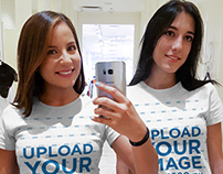 Two Girls Taking a Selfie Against a Mirror