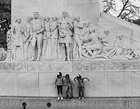 Kids playing on Statue, outside Alamo, San Antonio, TX,