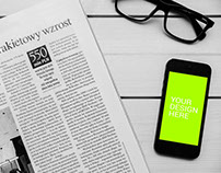 iPhone With NewsPaper Mockup - Free PSD