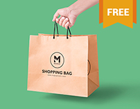 Free Handheld Paper Bag Mockup
