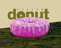 random donut floating above the green field.