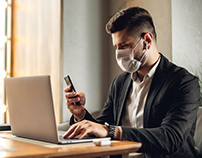 Businessman with face mask during pandemic COVID-19