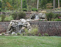 Building a Backyard Retaining Wall With The Clifrock