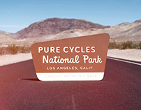 Pure Cycles National Park Sign