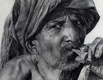 Pencil portrait of an Indian village old man smoking