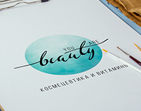 U.A. Beauty logo and business card