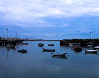 Sea, boats and clouds