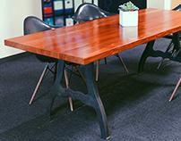 Table with padauk top and circa-1850 cast iron legs