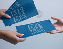 Brochure Mockup of a Person Handing Out Brochures