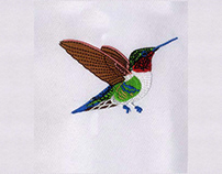 COLORFUL SOARING HUMMING BIRD EMBROIDERY DESIGN