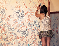 Jook is doodling on the wall of her son's bedroom