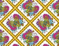 Estampa tipo lenço, com borboleta, flor e muita cor