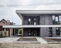 modern two-story house with a terrace by Addline group