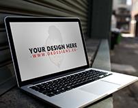 Free Macbook Pro Street Mockup PSD