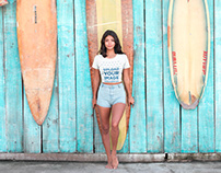 Latin Girl Near Surfboards Wearing a Tshirt Mockup