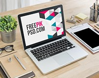 Macbook on Table Mockup Free Psd