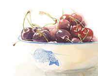 Still life composition of a bowl of cherries