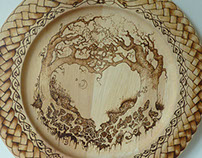 pyrography on wooden tray. Kissing trees