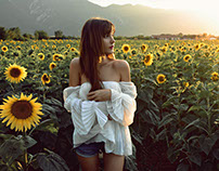 Sunflowers touch her skin...