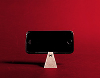 STAND – A mobile phone stand ring.