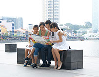 Family exploring Raffles Place, Singapore