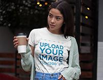 Tshirt Mockup of an Asian Girl Having a Coffee Outdoors