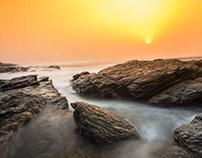 Sunrise between the Teshie rocks