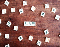 """Law"" spelled using scrabble tiles"