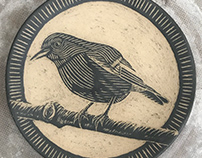 Sgraffito hand carved bird plates