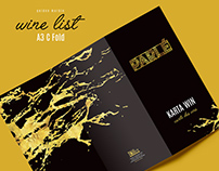 Golden marble on black wine list.