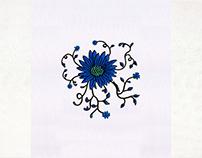 VINES SPREADING BLUE FLOWER EMBROIDERY DESIGN