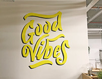 Vibewire 'Good Vibes' painted lettering mural