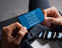 Mockup of a Businessman Holding a Business Card
