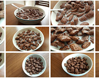 cereal flakes with cocoa on wooden table in white plate