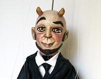 Marioneta - El banquero