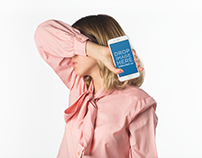 Girl Holding an iPhone Mockup Against her Face