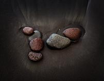 Stones on a black sand beach
