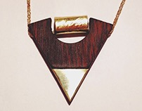Brass and gold pendant