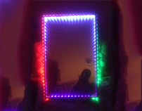 LED mirror with infinity effect and branding.