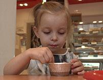 Little girl is eating dessert