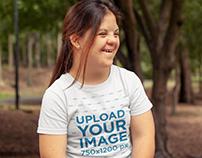 T-Shirt Mockup of a Smiling Woman at a Park